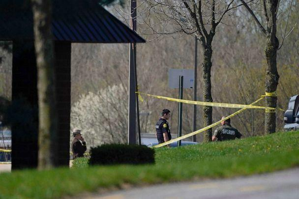 PHOTO: Police stand around an area cordoned off by police tape on Progress Court, near the scene of a shooting at a business park, in Frederick, Md., April 6, 2021. (Julio Cortez/AP)