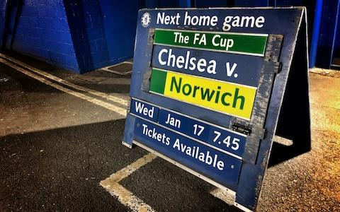 A board outside the stadium prior to The Emirates FA Cup Third Round Replay between Chelsea and Norwich City at Stamford Bridge on January 17 - Credit: Getty