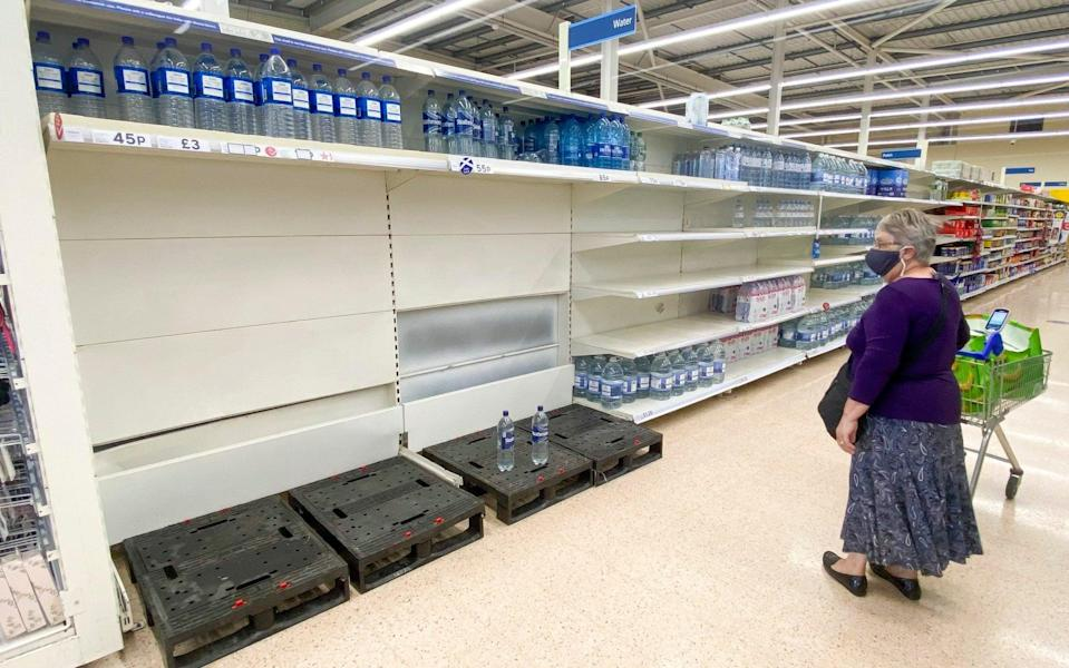 Depleted bottled water shelves at a Tesco in Bathgate, West Lothian - Katielee Arrowsmith/SWNS