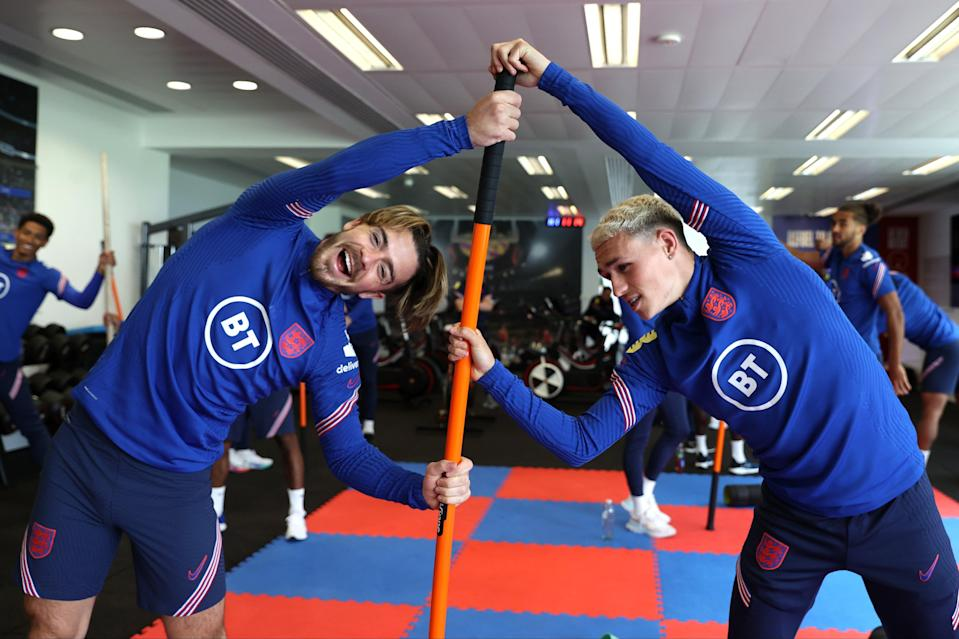Full stretch: Jack Grealish and Phil Foden in the gym during a training session at St George's Park  (The FA via Getty Images)