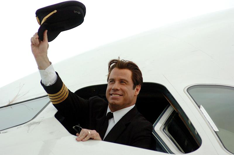 Qantas ambassador John Travolta waves from the cockpit of the Airbus A380 at Brisbane International Airport on Nov. 15 2005, before the plane flew over the city.