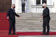Federal President Frank-Walter Steinmeier, right, welcomes the British heir to the throne Prince Charles for a talk in front of Bellevue Palace in Berlin, Sunday, Nov.15, 2020. The Prince of Wales and the Duchess of Cornwall are in Berlin on the occasion of the central commemoration of the Volkstrauertag. This year's Volkstrauertag in memory of the victims of National Socialism and the dead of both world wars is dedicated to German-British friendship. (Bernd von Jutrczenka/dpa via AP)