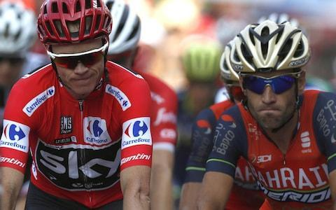 <span>Froome (left) and Vincenzo Nibali during stage 18 at the Vuelta a España</span> <span>Credit: EPA </span>