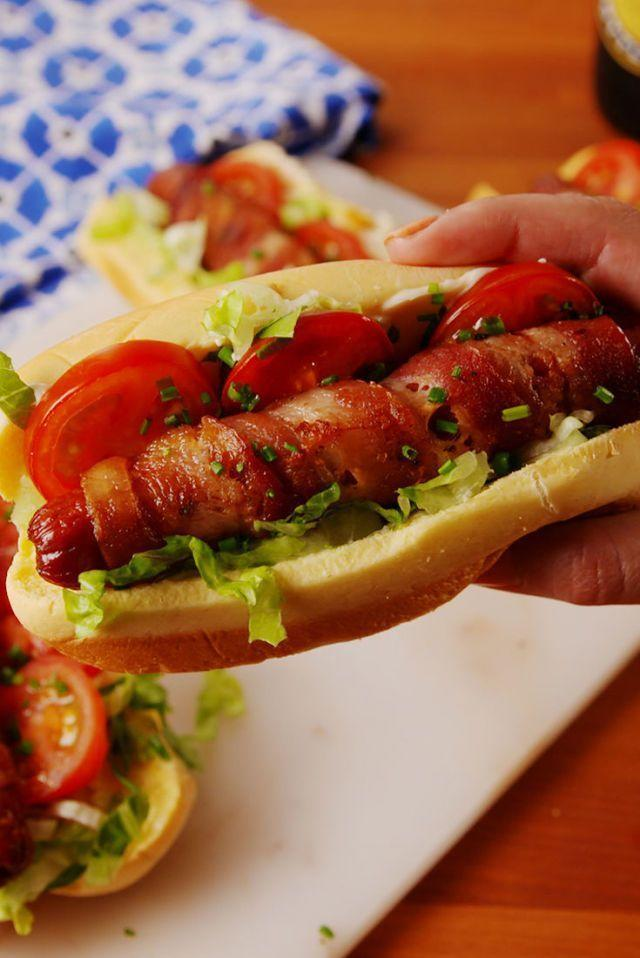 "<p>A bacon-wrapped hot dog is quite an achievement on its own, and when it's dressed up with the other BLT fixings it makes for the perfect hot dog sandwich. </p><p><strong><em>Get the recipe at <a href=""https://www.delish.com/cooking/recipe-ideas/recipes/a53692/blt-dogs-recipe/"" rel=""nofollow noopener"" target=""_blank"" data-ylk=""slk:Delish"" class=""link rapid-noclick-resp"">Delish</a>. </em></strong></p>"