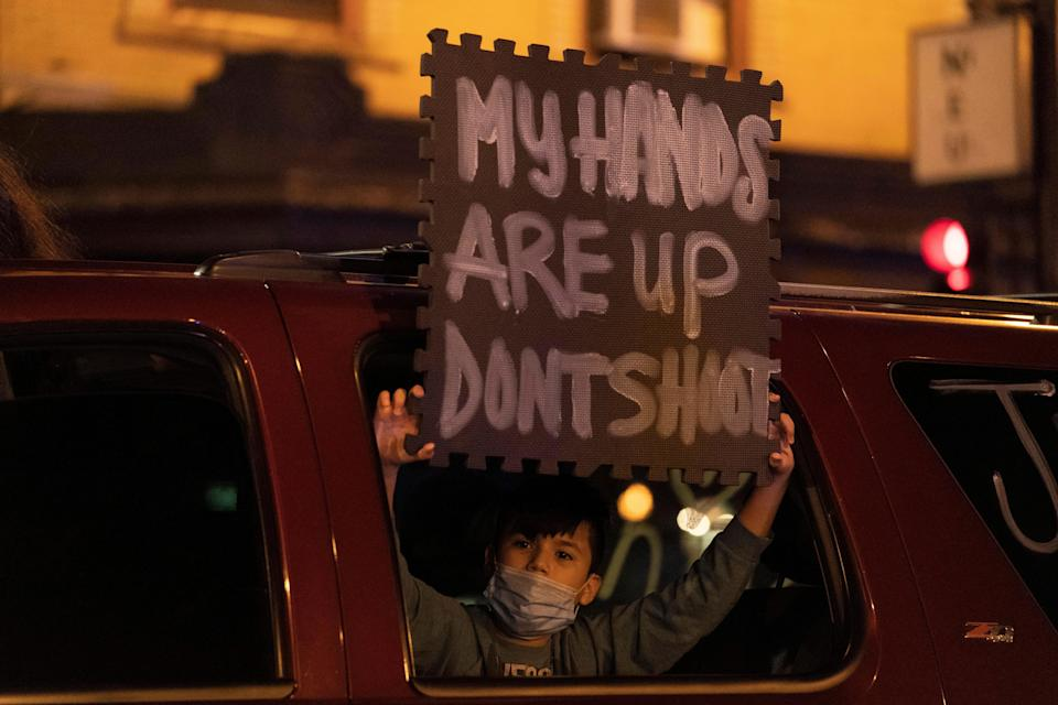 Protesters block an intersection following a march for 13-year-old Adam Toledo Friday April 15, 2021 in Chicago's Logan Square neighborhood.