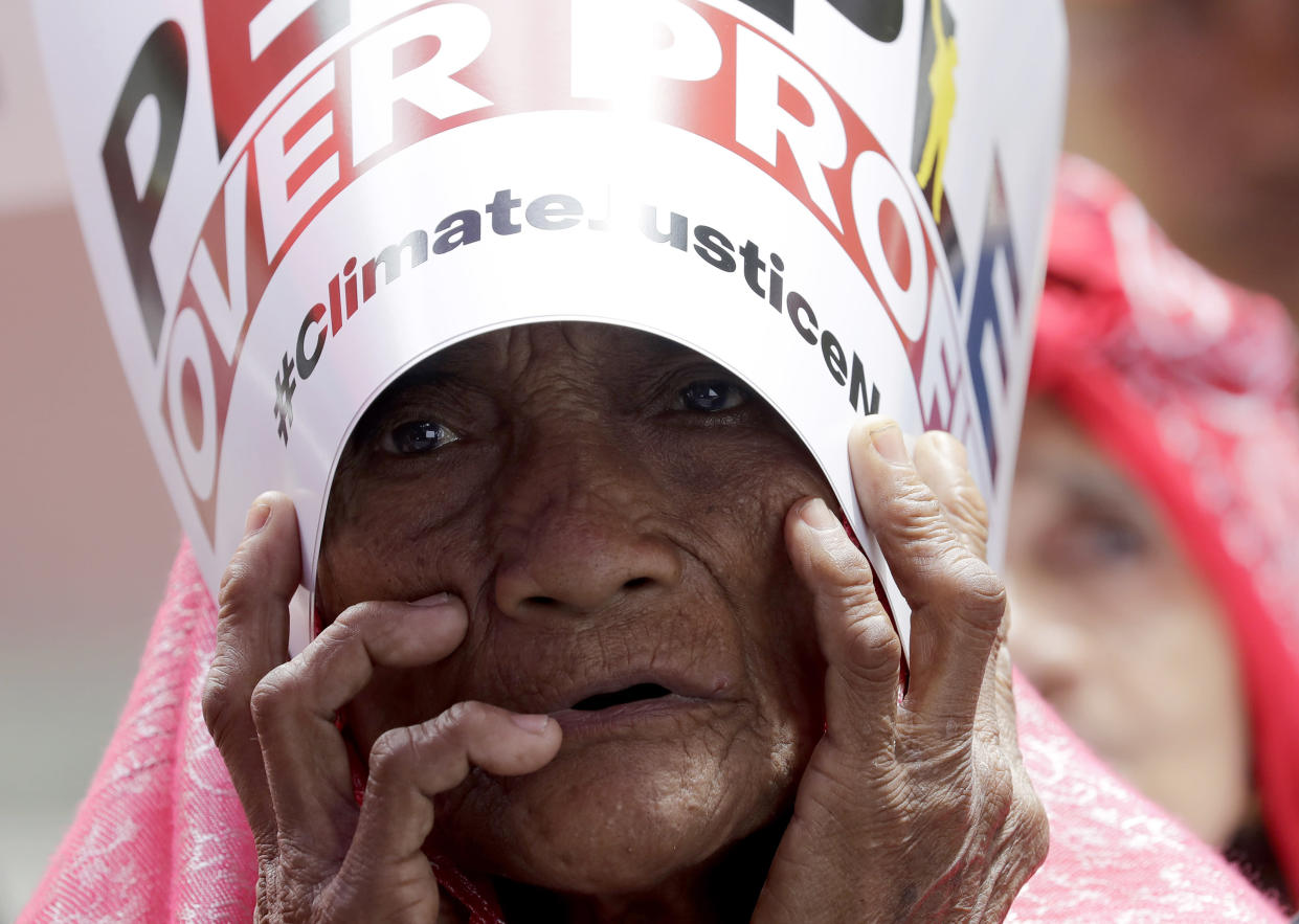 An environmental activist holds a placard during a rally outside the Department of Environment and Natural Resources to coincide with the global protests on climate change Friday, Sept. 20, 2019 at suburban Quezon city northeast of Manila, Philippines. (Photo: Bullit Marquez/AP)