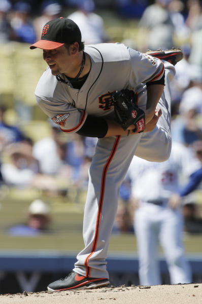 San Francisco Giants starting pitcher Ryan Vogelsong throws to the Los Angeles Dodgers during first inning of a baseball in Los Angeles, Sunday, Sept. 15, 2013. (AP Photo/Chris Carlson)