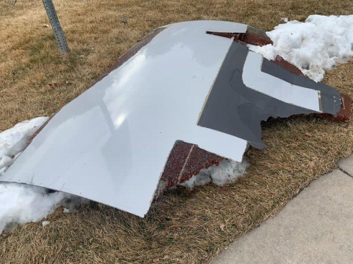A piece of plane debris is seen in Broomfield