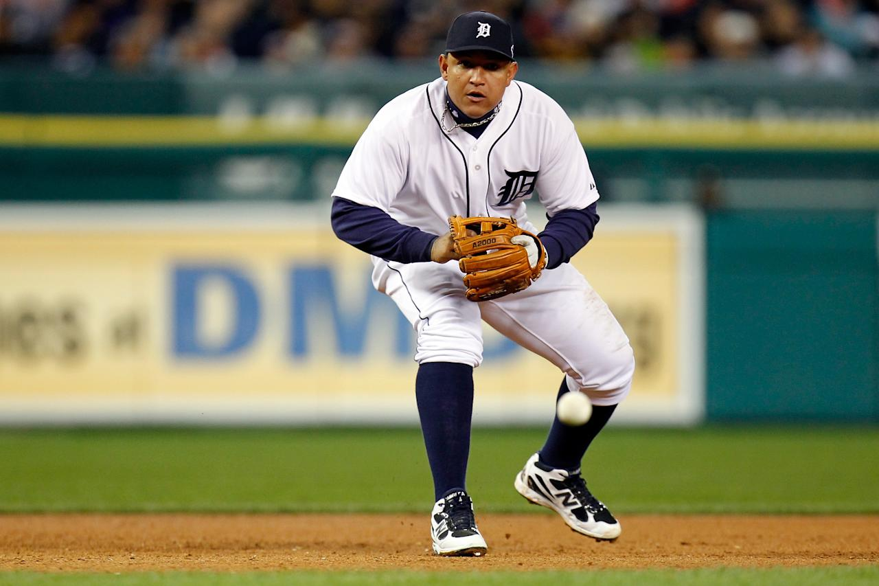 DETROIT, MI - OCTOBER 06:  Miguel Cabrera #24 of the Detroit Tigers fields a ball against the Oakland Athletics during Game One of the American League Division Series at Comerica Park on October 6, 2012 in Detroit, Michigan.  (Photo by Gregory Shamus/Getty Images)