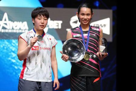 Badminton - Yonex All England Open Badminton Championships - Arena Birmingham, Birmingham, Britain - March 18, 2018 Taiwan's Tai Tzu Ying celebrates with the trophy after victory in the women's singles final alongside second placed Akane Yamaguchi of Japan Action Images via Reuters/Peter Cziborra