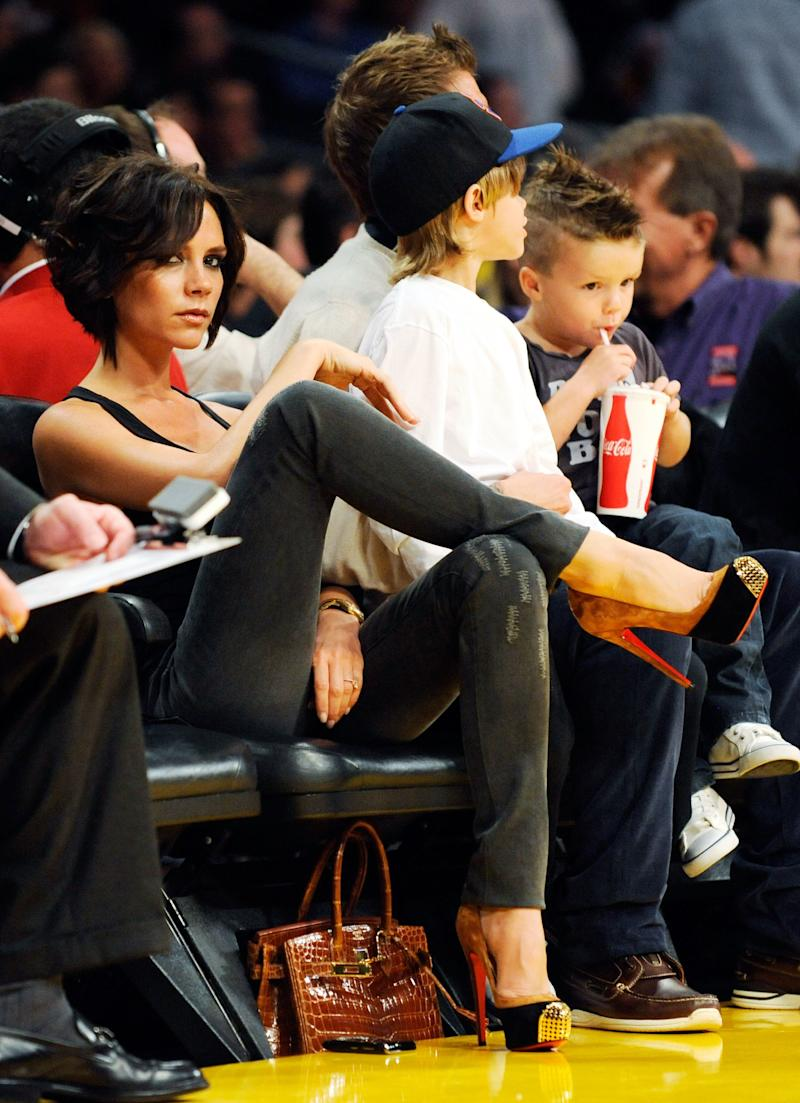 Victoria Beckham's nickname is Posh for a reason. While attending a game between the Los Angeles Lakers and the Dallas Mavericks with her husband David Beckham, and their children, Cruz and Romeo, the singer-turned-fashion designer put her platform heels on display.