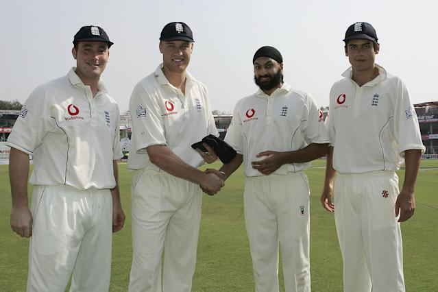 <p>Cook made his debut in England's first Test of the 2006 tour to India. Pictured here receiving his cap alongside Monty Panesar (second right) and Ian Blackwell (left) after a last minute dash from the Caribbean to Nagpur (Getty Images) </p>