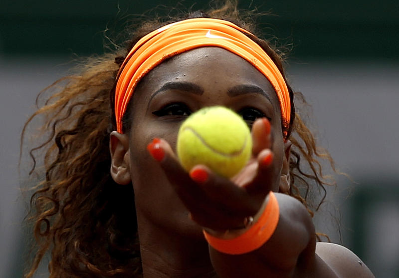 Serena Williams, of the U.S, serves the ball to Roberta Vinci, of Italy during their fourth round match of the French Open tennis tournament at the Roland Garros stadium Sunday, June 2, 2013 in Paris. Williams won 6-1, 6-3. (AP Photo/Petr David Josek)