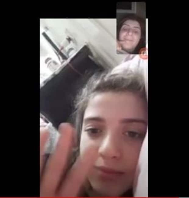 Jihan Qunoo (above) and her six-year-old daughter say good night through video phone apps. She is in Ottawa and her children are in Gaza where an escalating conflict with Israel has led to the deaths of at least 188 Palestinians.
