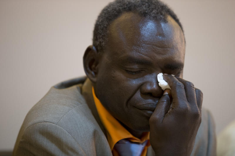 Clement Abaifouta, president of the association of victims of former Chadian dictator Hissene Habre, wipes away tears after he was overcome with emotion while listening to fellow victims recount their stories, at a press conference in Dakar, Senegal, Wednesday, July 17, 2013. Abaifouta, arrested in 1985, said he was forced for four years to dig graves for hundreds of prisoners, while his health deteriorated to the point where he was no longer able to walk. A lawyer said more than 1,000 victims of Habre have formally asked to participate in his trial on charges of war crimes, crimes against humanity and torture. (AP Photo/Rebecca Blackwell)