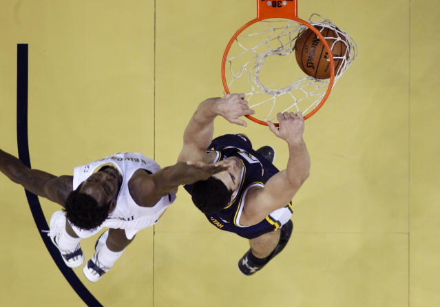 Utah Jazz center Enes Kanter, right, slam dunks in front of New Orleans Pelicans small forward Al-Farouq Aminu, left, in the first half of an NBA basketball game in New Orleans, Wednesday, Nov. 20, 2013. (AP Photo/Gerald Herbert)