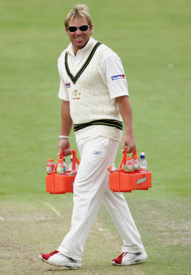 WORCESTER, UNITED KINGDOM - AUGUST 01:  Shane Warne of Australia carries the drinks during day three of the tour match between Worcestershire and Australia played at New Road on August 1, 2005 in Worcester, United Kingdom  (Photo by Hamish Blair/Getty Images)