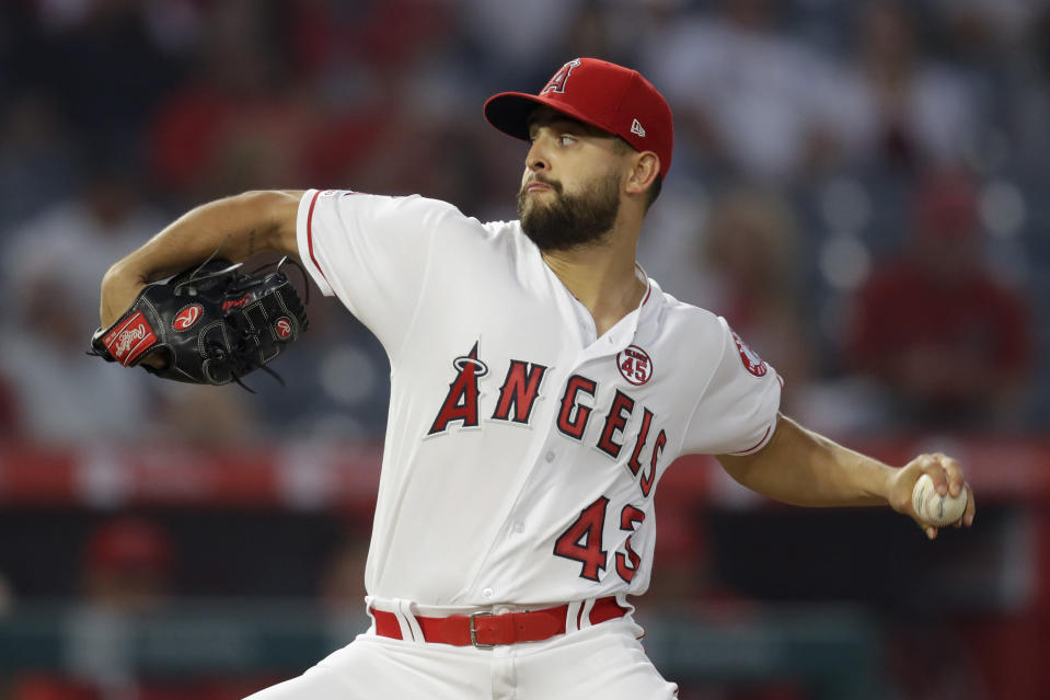 Los Angeles Angels starting pitcher Patrick Sandoval throws against the Cleveland Indians during the first inning of a baseball game in Anaheim, Calif., Monday, Sept. 9, 2019. (AP Photo/Chris Carlson)