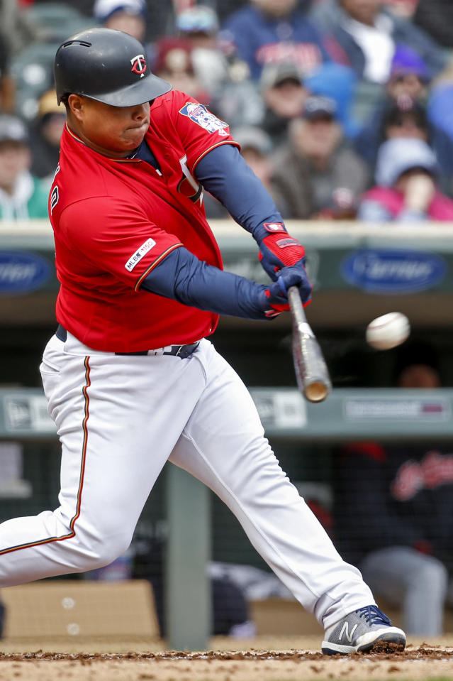 Minnesota Twins' Willians Astudillo hits a ground rule double against the Cleveland Indians in the fourth inning of a baseball game Sunday, March 31, 2019, in Minneapolis. (AP Photo/Bruce Kluckhohn)
