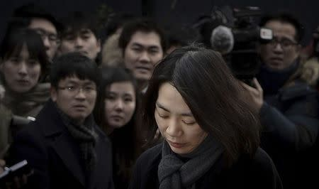 Cho Hyun-ah, also known as Heather Cho, daughter of chairman of Korean Air Lines, Cho Yang-ho, appears in front of the media outside the offices of the Aviation and Railway Accident Investigation Board of the Ministry of Land, Infrastructure, Transport, in Seoul December 12, 2014. REUTERS/Song Eun-seok/News1 (SOUTH KOREA