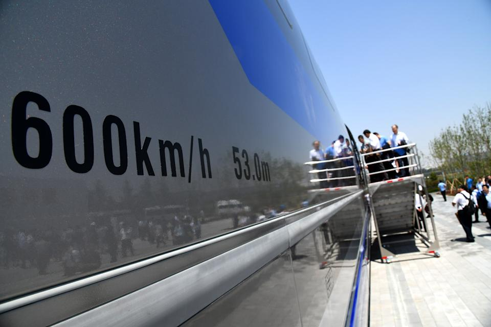 QINGDAO, May 23, 2019 -- Guests visit China's first high-speed maglev train testing prototype in Qingdao, east China's Shandong Province,on May 23, 2019. China on Thursday rolled off the production line a prototype magnetic-levitation train with a designed top speed of 600 km per hour in the eastern city of Qingdao.     The debut of China's first high-speed maglev train testing prototype marks a major breakthrough for the country in the high-speed maglev transit system.     The engineering prototype is scheduled to roll off the production line in 2020 and go through comprehensive tests to finish integrated verification in 2021. (Xinhua/Li Ziheng) (Xinhua/ via Getty Images)