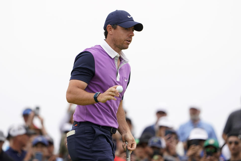 Rory McIlroy, of Northern Ireland, acknowledges the gallery after his birdie putt on the second green during the third round of the U.S. Open Golf Championship, Saturday, June 19, 2021, at Torrey Pines Golf Course in San Diego. (AP Photo/Jae C. Hong)