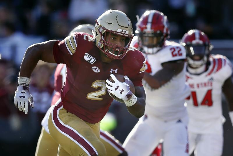 Boston College running back AJ Dillon (2) runs for a touchdown during the second half of an NCAA college football game against North Carolina State in Boston, Saturday, Oct. 19, 2019. (AP Photo/Michael Dwyer)