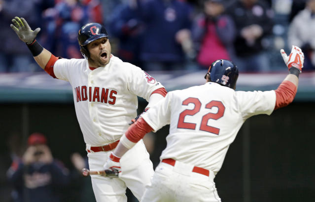 Cleveland Indians' Nick Swisher, left, celebrates with teammate Jason Kipnis after hitting a two-run home run off Minnesota Twins starting pitcher Mike Pelfrey in the sixth inning of a baseball game on Friday, April 4, 2014, in Cleveland. Lonnie Chisenhall also scored. (AP Photo/Mark Duncan)