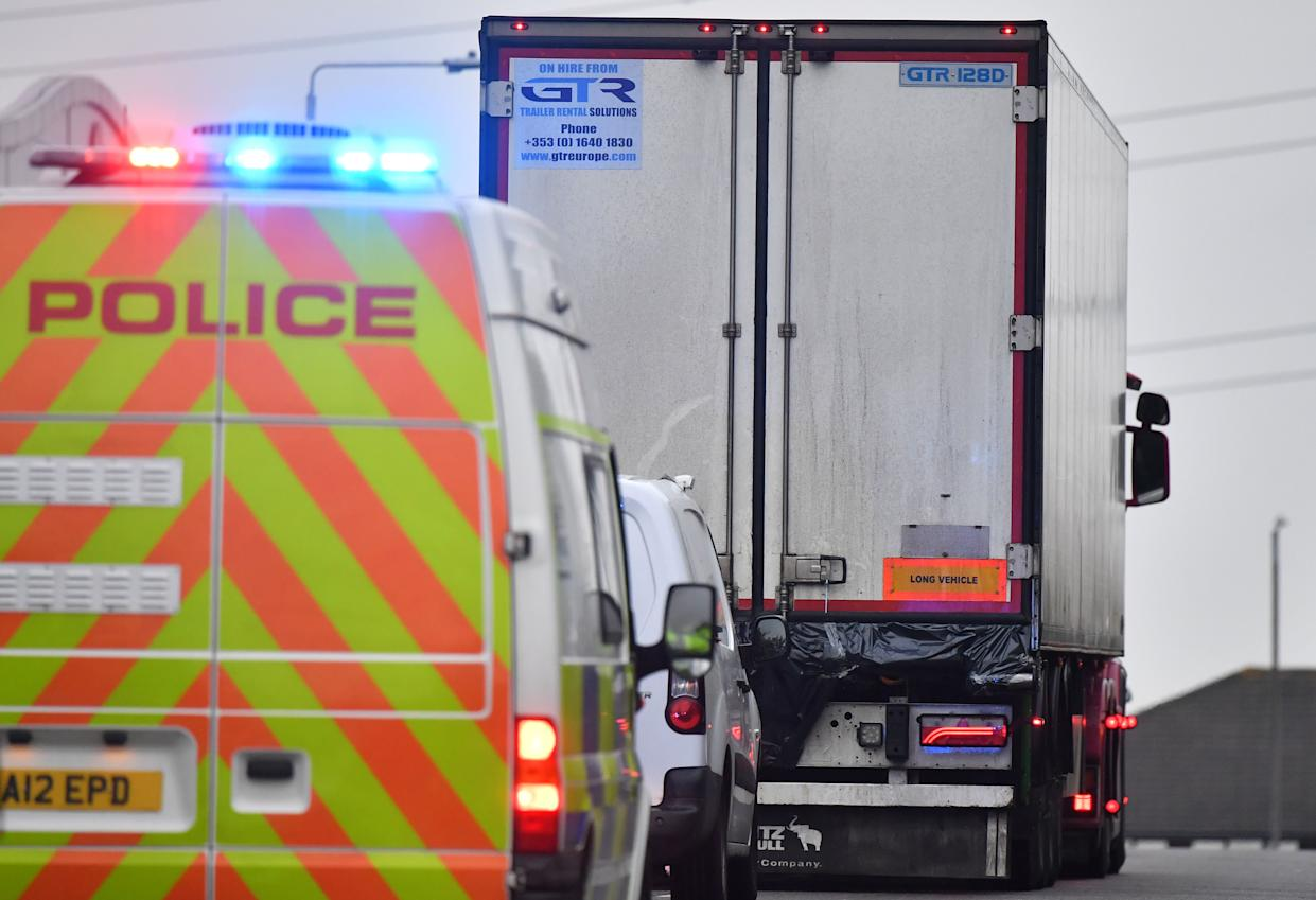 Police officers drive away a lorry in which 39 dead bodies were discovered at Waterglade Industrial Park in Grays, Essex (Picture: AFP/Getty)