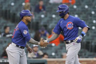 Chicago Cubs' Kris Bryant, right, celebrates his two-run home run with Willson Contreras against the Detroit Tigers in the third inning of a baseball game in Detroit, Friday, May 14, 2021. (AP Photo/Paul Sancya)
