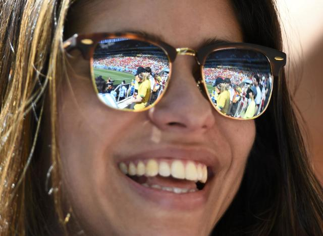A partial view of the stadium and its spectators are seen reflected in a fan's sunglasses as she waits for the start of the 2014 World Cup quarter-finals between Argentina and Belgium at the Brasilia national stadium in Brasilia July 5, 2014. REUTERS/Dylan Martinez (BRAZIL - Tags: SOCCER SPORT WORLD CUP)