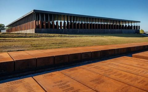 "A memorial to recognise thousands of African Americans who were lynched to death has opened in Alabama.  The National Memorial for Peace and Justice is the first memorial of its kind to recognise the thousands of black people who were victims of informal public executions at the hands of white supremacists.  It is the result of years of research documenting more than 4,000 killings by a group of lawyers.   The six-acre site includes a walkway with 800 weathered steel columns hanging from the roof, each listing the name of an American country and the people who were lynched there.  Along the walls the harrowing stories of some victims are detailed. One reads: ""Park Banks, lynched in Mississippi in 1922 for carrying a photograph of a white woman"". Another reads: ""Caleb Gadly, hanged in Kentucky in 1894 for walking behind the wife of his white employer"". 800 weathered steel columns, each one etched with the names of a lynching victim, hang from the roof of the memorial Credit: Audra Melton/The New York Times The story of Mary Turner, who was hung upside down by an angry white mob, burned and then cut open so her unborn child fell to the ground, is also told in the memorial. The memorial, which is located on a six-acre site in Montgomery, Alabama, is close to the Legacy Museum which once comprised part of the city's huge slave market but now serves as a companion to the monument. The memorial is the first of its kind in the US Credit: Audra Melton/The New York Times Bryan Stevenson, the founder of the Equal Justice Initiative, the group behind the memorial, said the purpose of the memorial was ""just seeing the names of all these people"". Many of them ""have never been named in public"", he told the New York Times, adding that representing them in one place gave a sense of scale to the bloodshed."