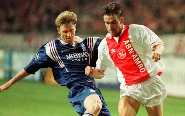 <span>The former Ajax winger Marc Overmars (R) is now the club's sporting director</span>