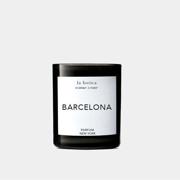 """<p><strong>La Botica</strong></p><p>garmentory.com</p><p><strong>$68.00</strong></p><p><a href=""""https://go.redirectingat.com?id=74968X1596630&url=https%3A%2F%2Fwww.garmentory.com%2Fsale%2Fla-botica%2Fcandles%2F632098-la-botica-barcelona-candle&sref=https%3A%2F%2Fwww.oprahdaily.com%2Flife%2Fg23584712%2Fbest-scented-candles%2F"""" rel=""""nofollow noopener"""" target=""""_blank"""" data-ylk=""""slk:SHOP NOW"""" class=""""link rapid-noclick-resp"""">SHOP NOW</a></p><p>If you're looking for a self-care gift for friends (or yourself!) this luxury small-batch, hand-poured candle is a winner. Featuring the alluring aromas of grapefruit, peony, rose, pink pepper, mandarin and musk, the home fragrance will immediately transform any space into an inviting sanctuary.</p>"""