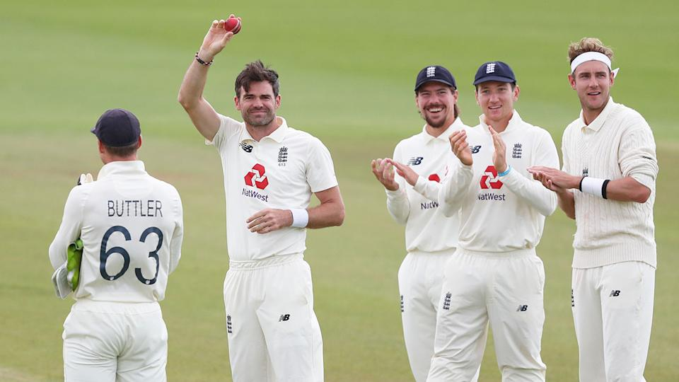 Seen here, Anderson's England teammates applaud his historic feat.