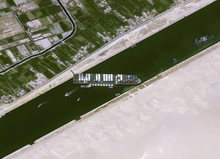 Satellite image shows the Taiwan-owned MV 'Ever Given' (Evergreen) container ship, a 400-metre- (1,300-foot-)long and 59-metre wide vessel, lodged sideways and impeding all traffic across Egypt's Suez Canal