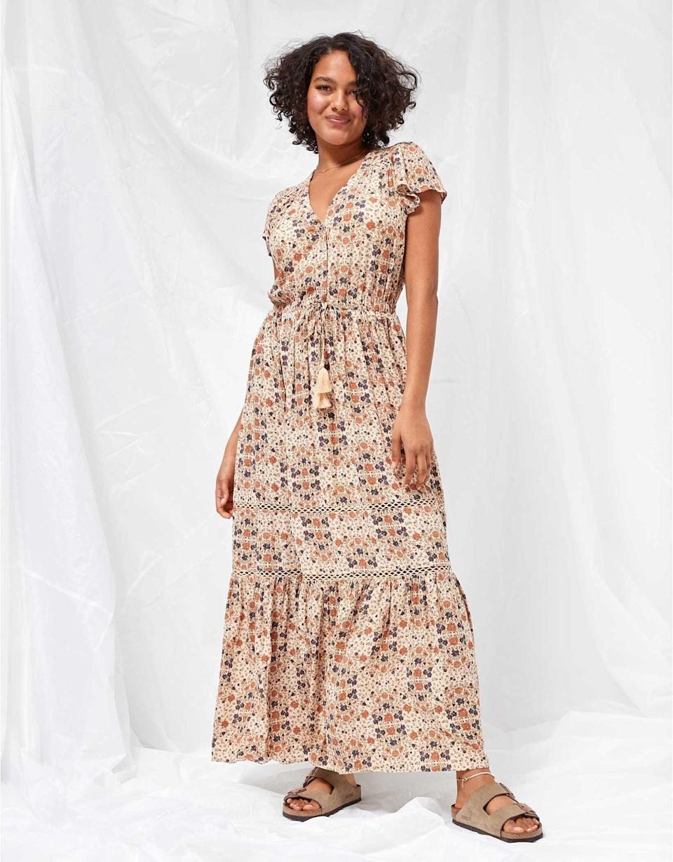 <p>This <span>AE Printed Tiered Maxi Dress</span> ($52, originally $70) is the answer to lazy days when you can't bother getting dressed but you'd still like to be put together. Complete the look with comfortable Birkenstock sandals, platform wedges, or sneakers.</p>