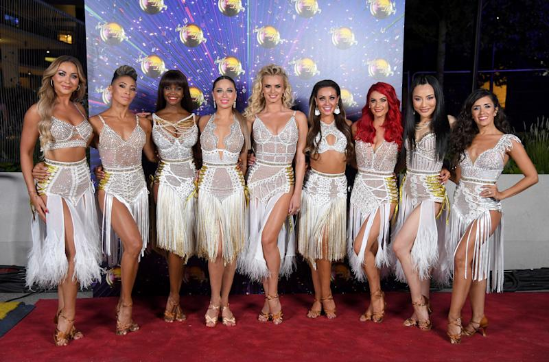 "LONDON, ENGLAND - AUGUST 26: (L-R) Luba Mushtuk, Karen Clifton, Oti Mabuse, Katya Jones, Nadiya Bychkova, Amy Dowden, Dianne Buswell, Nancy Xu and Janette Manrara attend the ""Strictly Come Dancing"" launch show red carpet arrivals at Television Centre on August 26, 2019 in London, England. (Photo by Karwai Tang/WireImage)"