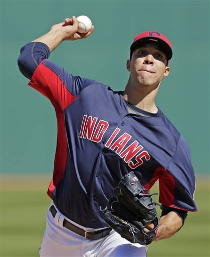 Cleveland Indians starting pitcher Ubaldo Jimenez throws during the first inning of a spring training baseball game against the San Diego Padres on Saturday, March 2, 2013, in Goodyear, Ariz. (AP Photo/Charlie Riedel)