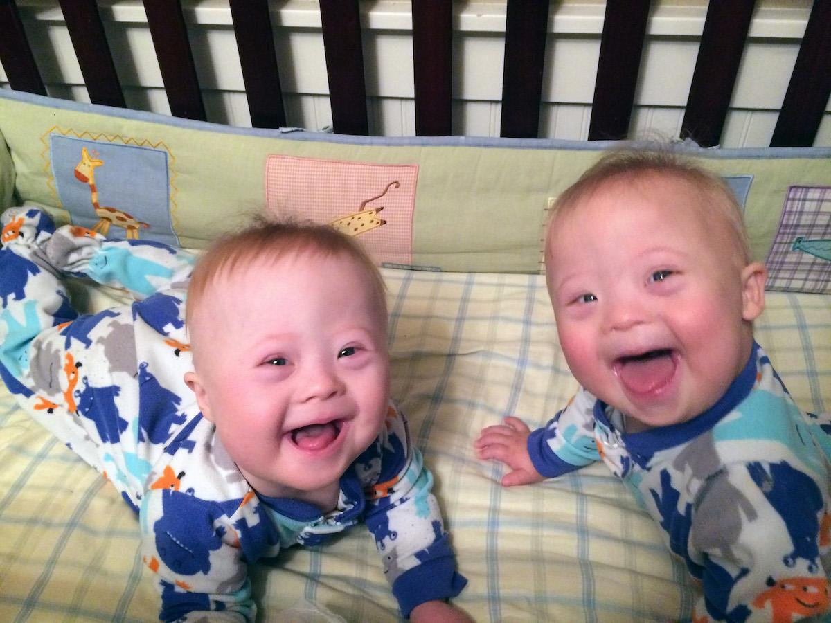 Pic from Caters News - (Pictured: left to right Charlie and Milo smile for the camera) Meet the Goofball Brothers the incredibly rare Down syndrome TWINS who are guaranteed to make you smile. Mum Julie McConnel, 45, from Nampa, Idaho, USA, already had four children when she fell pregnant for a fifth time last August. She and her husband Dan, 46, had hoped to give their three-year-old son Andy a little sister, but instead fell pregnant with twin boys, Charlie and Milo. Because of Julies age, she knew that the likelihood of having multiples or a child with Down syndrome would be greater, but she never expected both to happen. She admits she was distraught when she learned the news Charlie and Milo had the condition and even considered putting them up for adoption, fearing that she and her husband didnt have the capacity to care for two children with special needs. Now Julies sharing her story to show others that having a child with special needs isnt as scary as they may think and her Goofball Brothers - named after a sketch in the film The Wedding Singer - are proof of that. SEE CATERS COPY