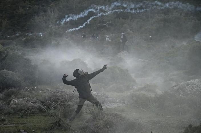 Protesters faced off against riot police on the island for the second day (AFP Photo/ARIS MESSINIS)