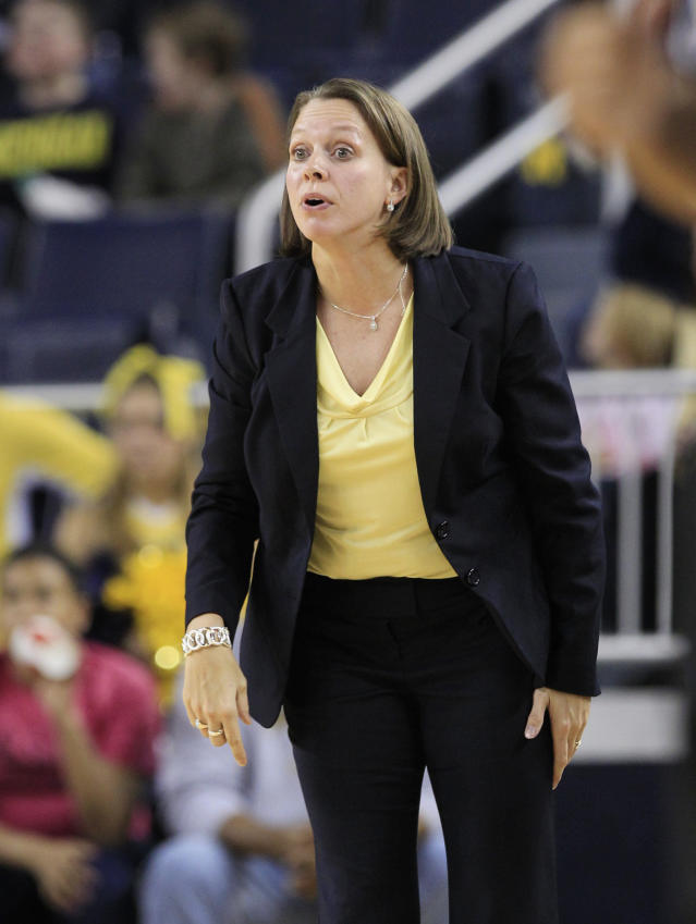 Michigan women's assistant coach DawnPlitzuweit directs from the sidelines during the second half of an NCAA college basketball game against Ohio State in Ann Arbor, Mich., Saturday, Jan. 7, 2012. (AP Photo/Carlos Osorio)