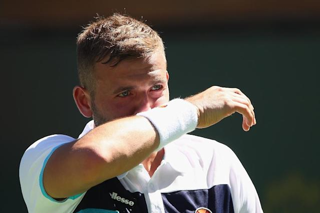 Britain's Dan Evans was banned from tennis for a year over drug-taking (AFP Photo/CLIVE BRUNSKILL)