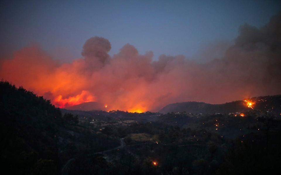 Fire engulfs the sky around the village of Cokertme, in Bodrum, late on Sunday night - Emre Tazegul/AP