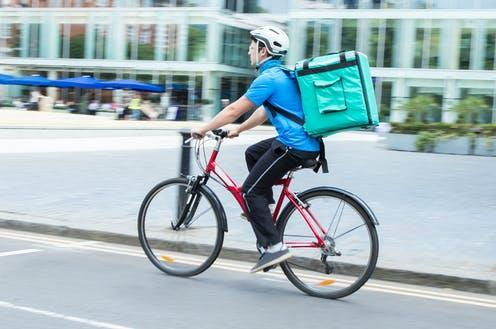 """<span class=""""attribution""""><a class=""""link rapid-noclick-resp"""" href=""""https://www.shutterstock.com/image-photo/courier-on-bicycle-delivering-food-city-674369497"""" rel=""""nofollow noopener"""" target=""""_blank"""" data-ylk=""""slk:Shutterstock/Daisy Daisy"""">Shutterstock/Daisy Daisy</a></span>"""