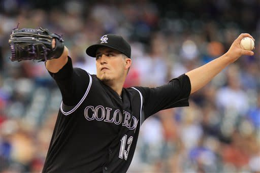 Colorado Rockies starting pitcher Drew Pomeranz delivers to Cincinnati Reds' Zack Cozart during the first inning of a baseball game on Friday, July 27, 2012, in Denver. (AP Photo/Barry Gutierrez)