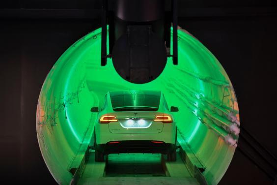A modified Tesla Model X electric vehicle enters a tunnel before an unveiling event for The Boring Company Hawthorne tunnel in Hawthorne, California, 18 December 2018 (Rex Features)