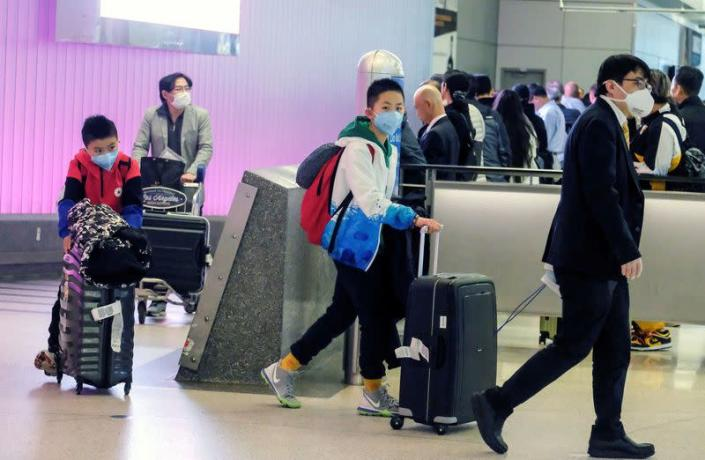 FILE PHOTO: Passengers arrive at LAX from Shanghai, China