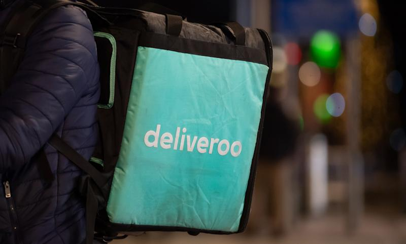 CARDIFF, UNITED KINGDOM - DECEMBER 20: A close-up of a Deliveroo rider's bag at night on December 20, 2019 in Cardiff, United Kingdom. (Photo by Matthew Horwood/Getty Images)