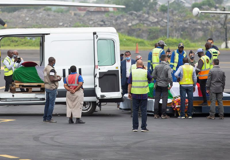 Officials prepare to load the bodies the slain Italian ambassador Congo Luca Attanasio and his security into a military plane at the Goma airport